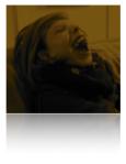 headshot of Mac, big open mouth grin, scruncy nose, sepia print