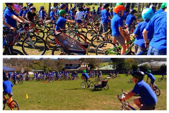 Top pic kids on bikes, vibrant colours, bike helmets, bright blue school uniforms prevail, Mac in his jogger in the midst of it all.  bottom pic kids in the distance, Mac and his mate riding up to meet the crowd.